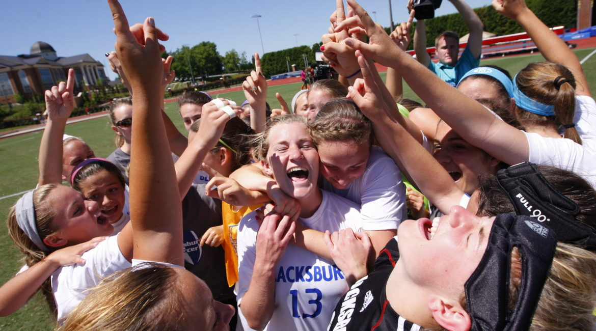 After defeating Kettle Run 1-0, Jane Everett (center) and teammates celebrate Blacksburg's first ever girls soccer state championship.